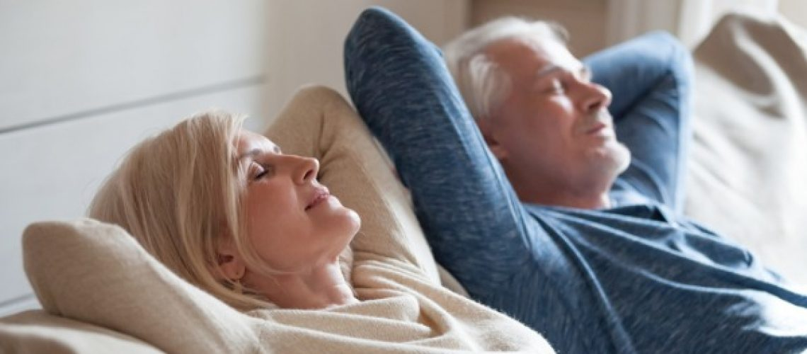 calm-mature-couple-relaxing-on-sofa-having-daytime-nap-together-picture-id1049512746 (1)